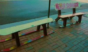 Wait for seating on these benches outside pizza place.