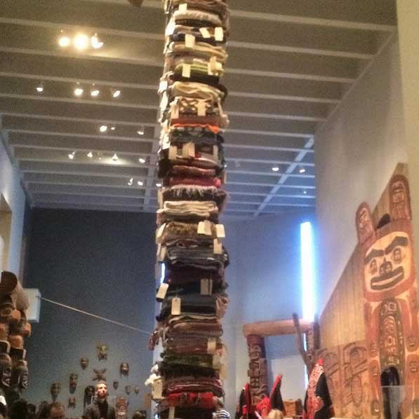 Blankets stacked from floor to ceiling, each tagged