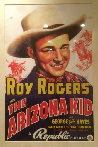 One of many framed posters in the hallway of the hotel. Anybody know who Roy Rogers is?